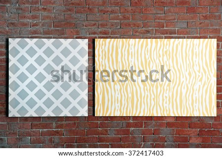 Abstract pictures on a brick wall background - stock photo
