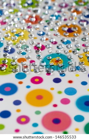 abstract picturing of water drops and their colorful reflections   - stock photo