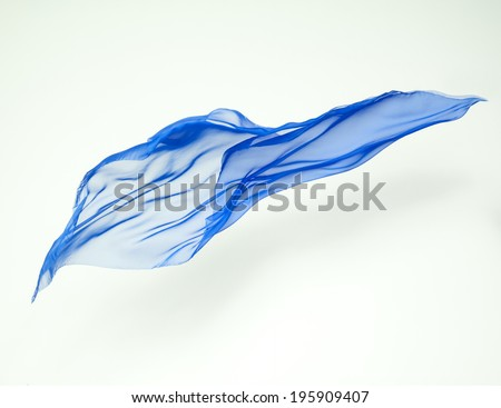 abstract piece of blue fabric flying, studio shot, design element - stock photo
