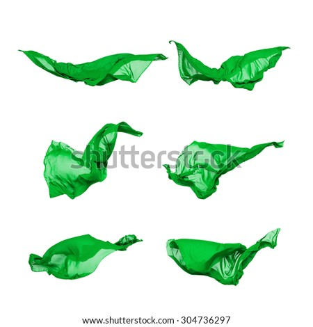 abstract pieces of fabric flying, isolated on white, design element - stock photo