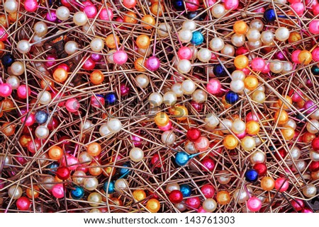 Abstract pins with multicolored ball heads in pile - stock photo