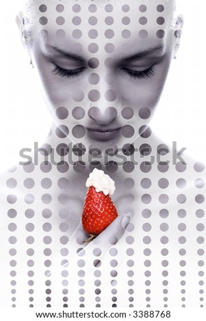 Abstract portrait of a girl with red juicy strawberry in her hand - stock photo