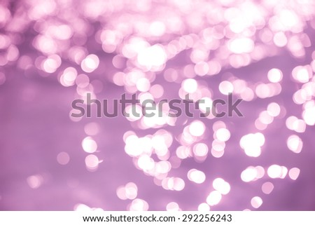 Abstract purple bokeh light background - stock photo