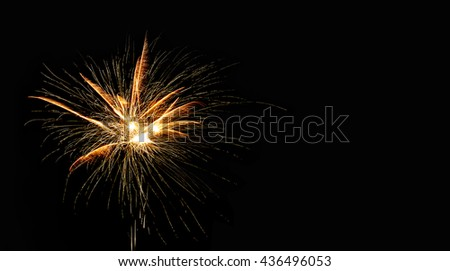 Abstract pyrotechnic glowing explosion on black background. fireworks landscape. Golden flash. Festival card design template. copy space - stock photo