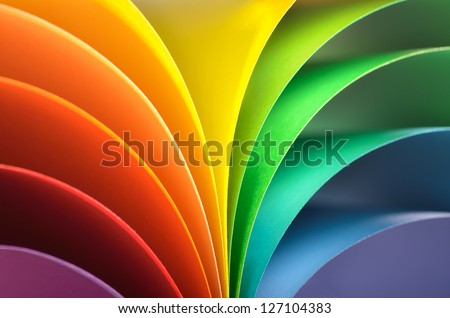 Abstract rainbow background with colored paper.Dark tones. - stock photo