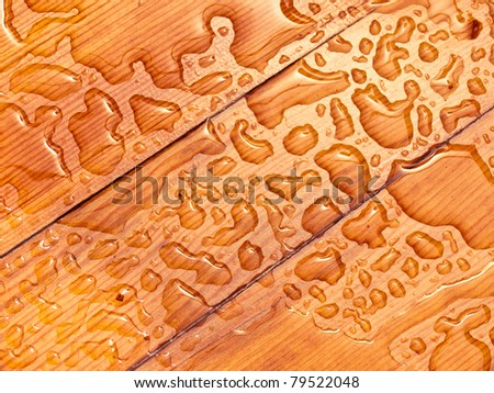 abstract raindrops pattern on wooden board - stock photo