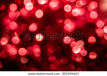 Abstract red and pink circular bokeh background of Christmas light - stock photo