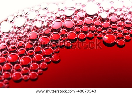 abstract red wine bubbles, close-up shot - stock photo
