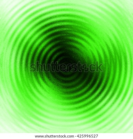 Abstract ripple in water with green concentric circles. Droplet falling in water.  - stock photo