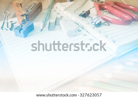 Abstract School and office supplies on wood background. Back to school. made with color filters,blurred focus. - stock photo