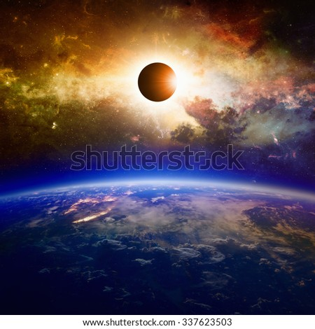Abstract scientific background - planet Earth in space, full solar eclipse, red glowing galaxy. Elements of this image furnished by NASA nasa.gov - stock photo