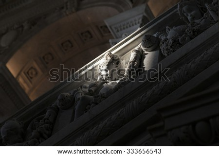 Abstract : Sculpture of Cupid with sunlight only its face in the dawn. - stock photo