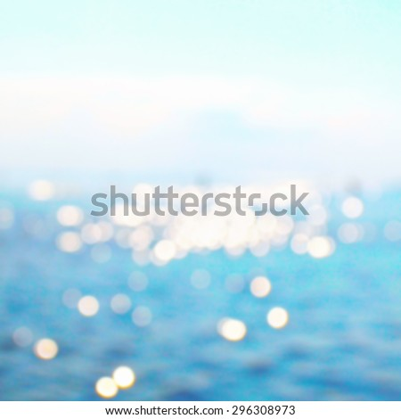 Abstract sea view water bokeh in sunny morning day - stock photo