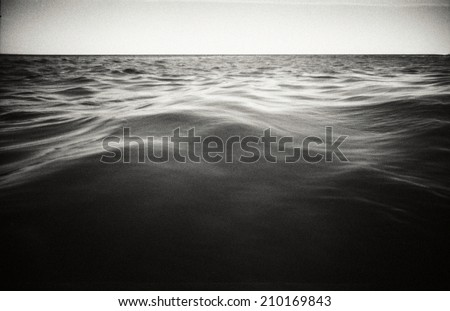 Abstract seascape background. Original film shot. Image contains grain and blur. - stock photo