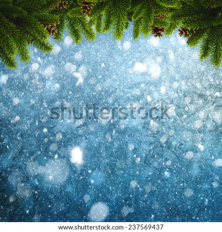 Abstract seasonal backgrounds with christmas decorations and snow fall - stock photo