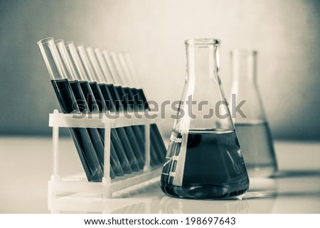 Abstract set of different chemistry glassware in a lab - stock photo