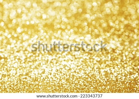 Abstract shining glitters gold holiday bokeh background - stock photo