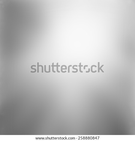 abstract shiny silver gray background with smooth blurred texture, black and white monochrome print background template - stock photo