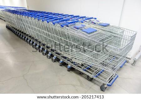 abstract shopping carts at parking lot - stock photo