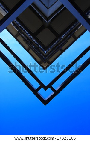 Abstract shot of building against blue sky - stock photo