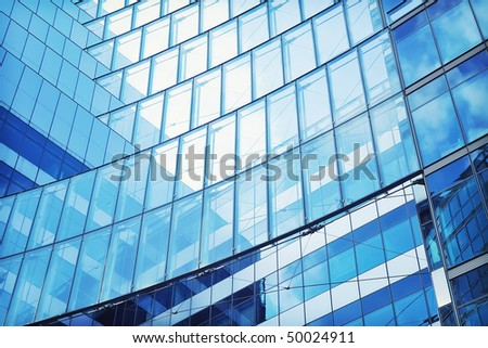 Abstract shot of modern building, with structural lines and reflection. - stock photo