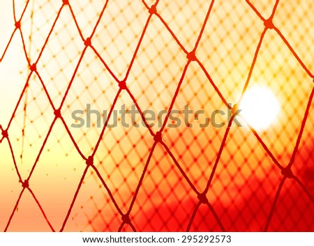 Abstract, Silhouette colorful of goal net soccer in the sunset  - stock photo