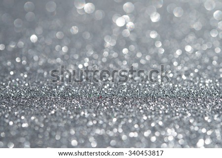Abstract silver glitter holiday background. Winter xmas theme. Christmas. - stock photo