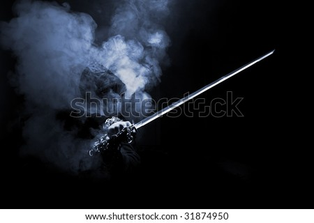 abstract smoky fighter with sword - stock photo