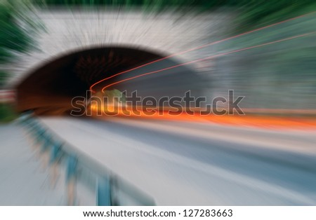 Abstract speed. Car light trails in the tunnel. Very art image . Long exposure photo taken in a tunnel - stock photo