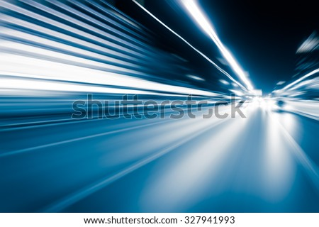 Abstract speed motion in highway road tunnel, blurred motion toward the central - stock photo