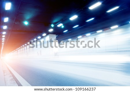 Abstract speed motion in urban highway road tunnel, blurred motion toward the central. - stock photo