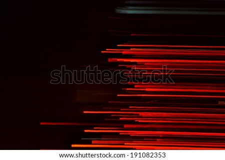 Abstract speedy drive on black asphalt road at night background. - stock photo