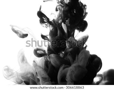 Abstract splash of black paint on black background - stock photo