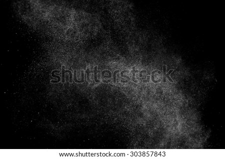abstract splashes of water on a black background.  - stock photo