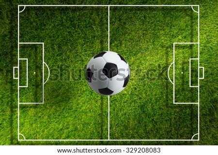 Abstract sports background - soccer ball above green stadium with layout, bright light from spotlight - stock photo
