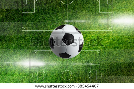 Abstract sports background - soccer ball on green grass, green field with layout, bright flare - stock photo
