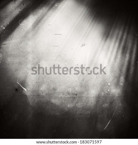 Abstract sunlight on film. Lots of grain, scratches and dust. - stock photo