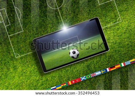 Abstract technological background - soccer ball and stadium on screen of smartphone, sports game online, field layout - stock photo