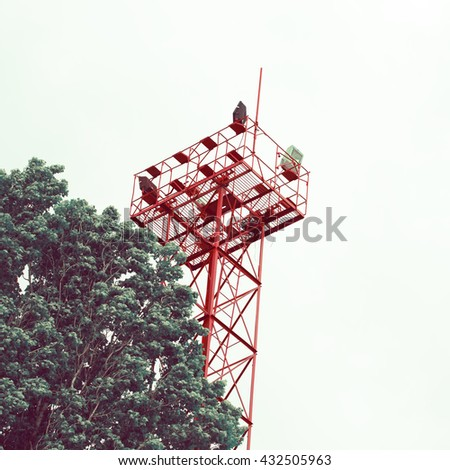 Abstract technology background - tree and a tower - stock photo
