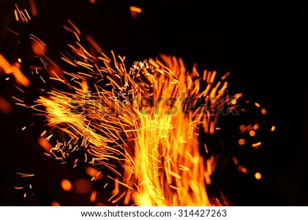 Abstract texture. Fire flames on a black background - stock photo