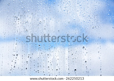 Abstract texture - water drops on glass - stock photo