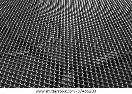 Abstract textured background of metal grill - stock photo