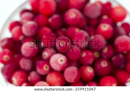 abstract the background of frozen cranberries blurred background selective focus on one berry - stock photo