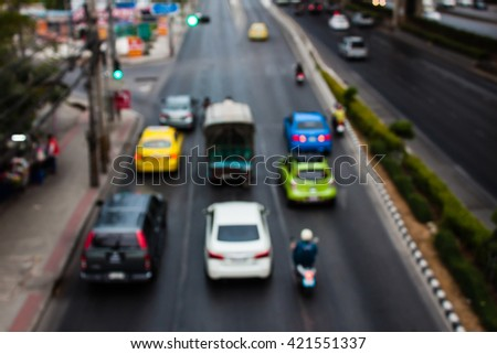 abstract traffic jams night light with cross process filter background with blurry shallow depth of focus. - stock photo