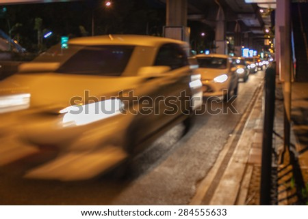 abstract traffic speed night light background with blurry shallow depth of focus. - stock photo