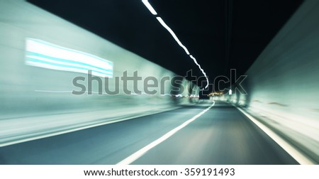 abstract tunnel motion blur background with lights - stock photo