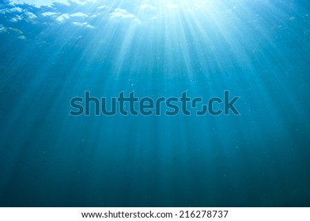 Abstract underwater background with sunlight - stock photo