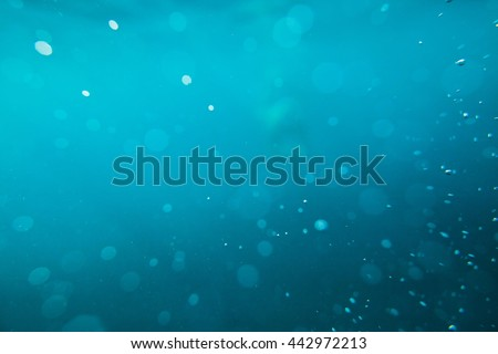 abstract underwater sea background bokeh - stock photo
