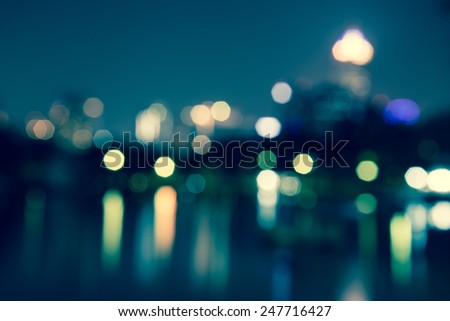 Abstract urban night light bokeh, defocused background - stock photo