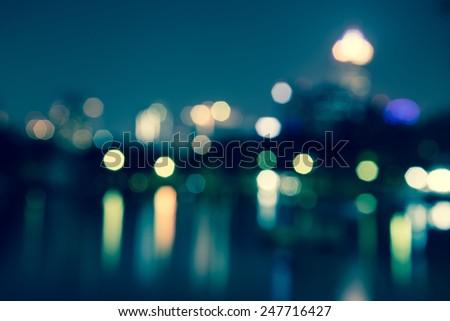 Abstract urban night light bokeh, defocused background - stock photo